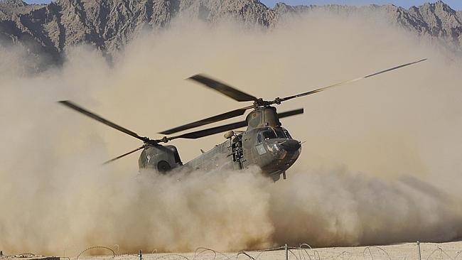 A CH-47 Chinook helicopter from C Squadron, 5th Aviation Regiment, stirs up the dust as it lands at Patrol Base.
