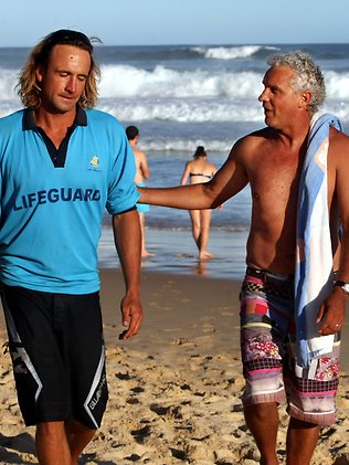 Redhead Beach ... (L to R) Lifeguard Danny Napper, who was the first to apply first aid to the injured surfer, and Steve Tidy, who was surfing with him when he was bitten. Picture: Robert McKell