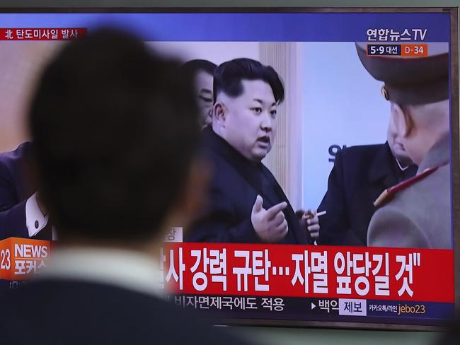 A man watches a TV news program showing a file footage of North Korean leader Kim Jong Un, at Seoul Train Station in Seoul, South Korea, Wednesday, April 5, 2017. Picture: Lee Jin-man