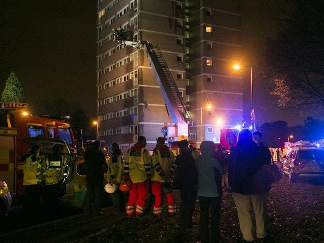 Emergency services at the scene of the fire at Coolmoyne House in Dunmurry. Picture: AAP