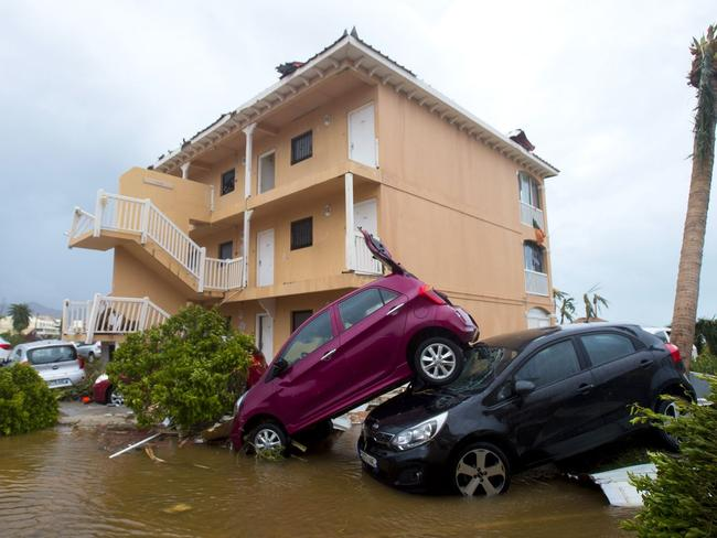 Cars piled on top of one another in Marigot on the French Collectivity of Saint Martin. Picture: Lionel Chamoiseau/AFP