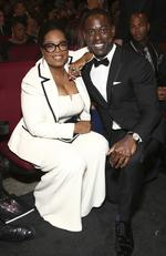 Oprah Winfrey and Sterling K. Brown pose in the audience at the 69th Primetime Emmy Awards on Sunday, Sept. 17, 2017, at the Microsoft Theater in Los Angeles. Picture: AP