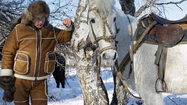 Putin the horse whisperer. Picture: AP.
