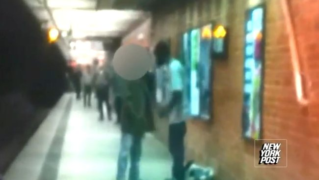 A screen grab of a video showing a confrontation which witnesses said preceded the man on the right pushing the man on the left to his death on a New York City subway track.