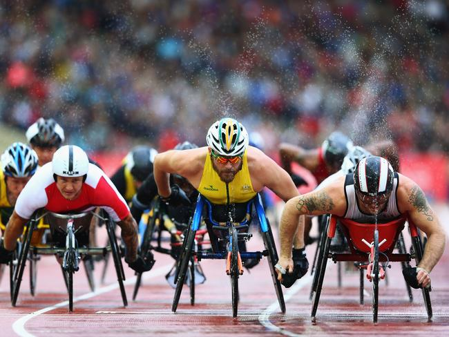 (L-R) David Weir of England, Kurt Fearnley of Australia and Alex Dupont of Canada competes in the Men's T54 1500 metres final.