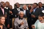 <p>Former South African President Nelson Mandela and his former wife Winnie Madikizela-Mandela, right, toast the upcoming 20th anniversary of Mandela's release from prison, with family, friends and former activists of the liberation struggle.</p>