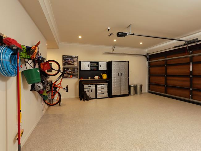 A garage that dad can be proud of offering plenty of storage options. Picture: John Fotiadis