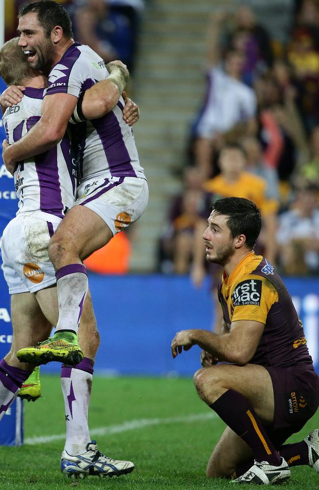Storms Ryan Hinchcliffe celebrates his try with Cam Smith as Broncos Ben Hunt watches on.