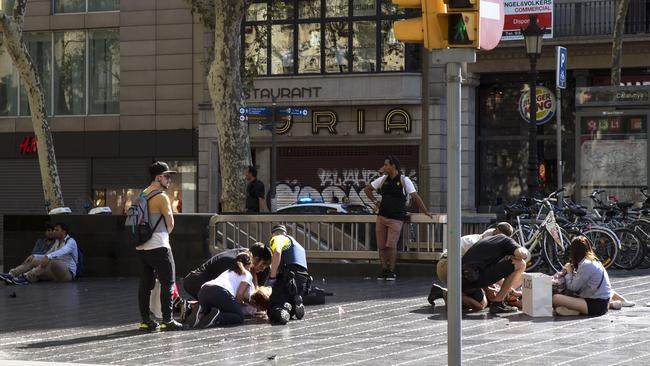 Injured people are tended to at the scene of a terrorist attack in the Las Ramblas area on August 17, 2017 in Barcelona, Spain. Picture: Nicolas Carvalho Ochoa/Getty Images.