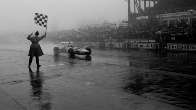 Stewart takes the chequered flag in the 1968 German GP.