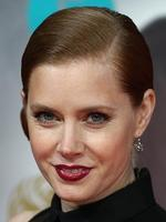 Amy Adams arrives on the red carpet for the BAFTA British Academy Film Awards at the Royal Opera House in London on February 16, 2014. Picture: AFP