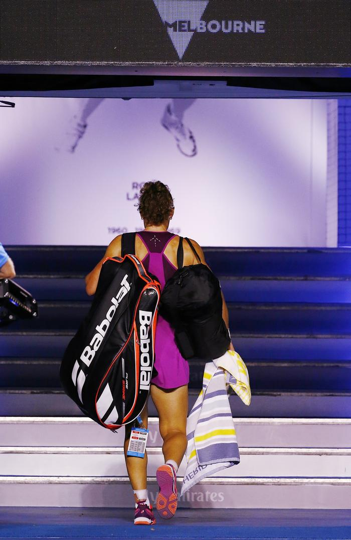 Sam Stosur cuts a sad figure as she leaves the arena. Picture: Colleen Petch