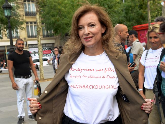 High profile ... Former French first lady Valerie Trierweiler shows her T-shirt reading 'Bring back our girls, secure walking school'. The high international interest in the fate of the Nigerian schoolgirls may have prompted terrorist group Boko Haram to look after the girls as bargaining chips. Picture: AFP