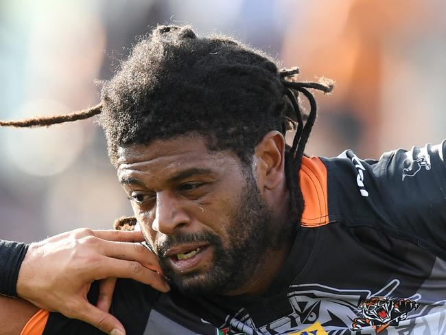 Jamal Idris (right) of the Tigers is tackled by Dean Whare of the Panthers during the round 2 NRL match between the West Tigers and the Penrith Panthers at Campbelltown Stadium in Sydney on Sunday, March 12, 2017. (AAP Image/Paul Miller) NO ARCHIVING, EDITORIAL USE ONLY