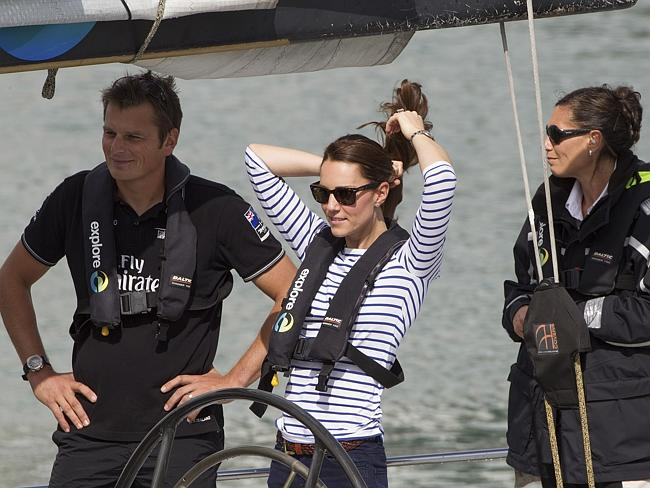 Aye aye Skipper! ... Kate, the Duchess of Cambridge, with Team New Zealand akipper Dean Barker, left, sailing on an America's Cup yacht in Auckland on Friday. Pic: AP Photo/SNAP, David Rowland.