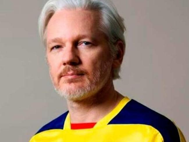 Julian Assange wearing an Ecuador football top in a picture posted on Twitter after Ecuador requested he be granted diplomatic status. Picture: Twitter.