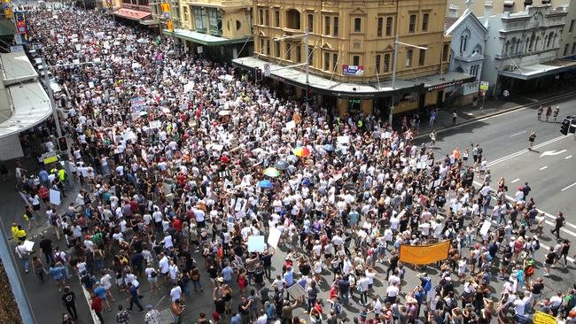 The crowd made their way through the city. Pic Stephen Cooper