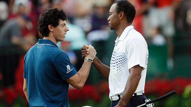 Rory McIlroy, left, of Northern Ireland, and Tiger Woods shake hands on the 18th green after completing the first round of the Tour Championship golf tournament, Thursday, Sept. 20, 2012, in Atlanta. Woods finished 4-under 66 to earn him a share of the lead. (AP Photo/John Bazemore)