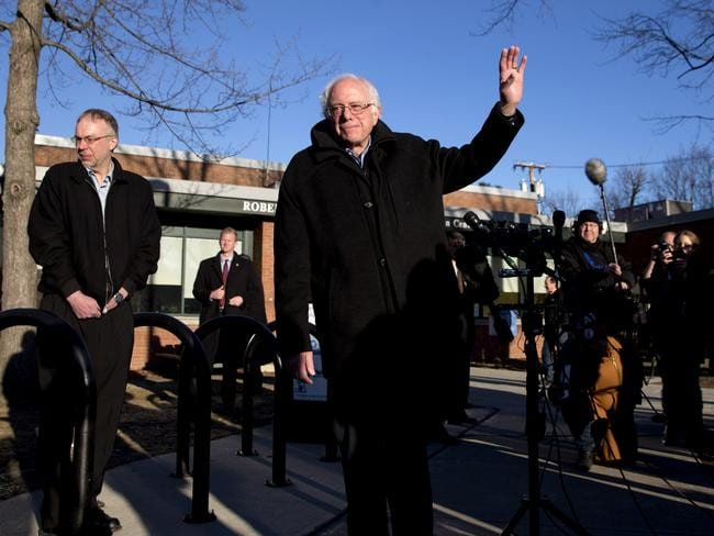Democratic presidential candidate Senator Bernie Sanders waves as he leaves a news conference after voting in the Vermont primary.