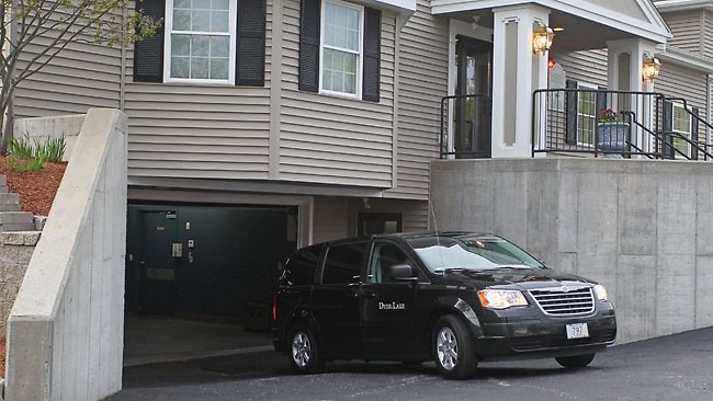A vehicle believed to be carrying the body of Boston Marathon bombing suspect Tamerlan Tsarnaev backs into an underground garage at the Dyer-Lake Funeral Home, Thursday, May 2, 2013, in North Attleborough, Mass. The body of Tsarnaev, who was the subject of a massive manhunt and died after a gunbattle with police, was claimed on Thursday. (AP Photo/Stew Milne)