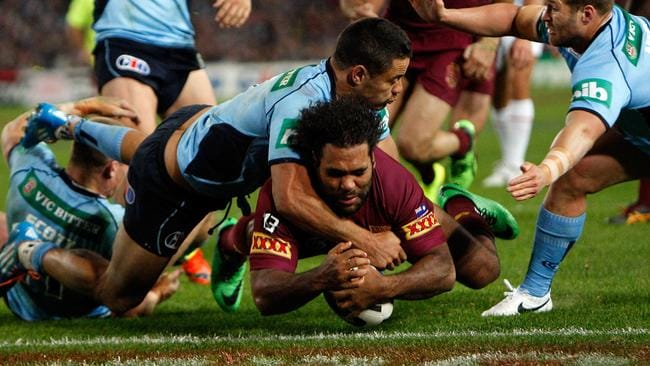 Jarryd Hayne's intervention sees Sam Thaiday lose the ball over the try line.