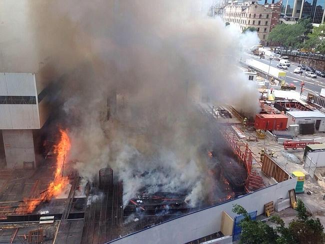 Flames shoot out of the Barangaroo construction site.