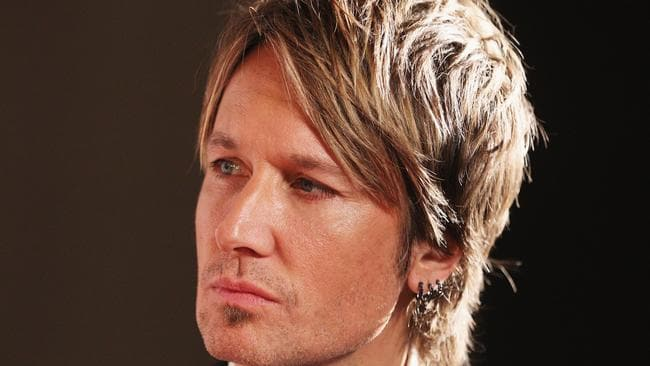 Keith Urban: Possibly so sullen because of another wardrobe fight with Nicole. Getty Images