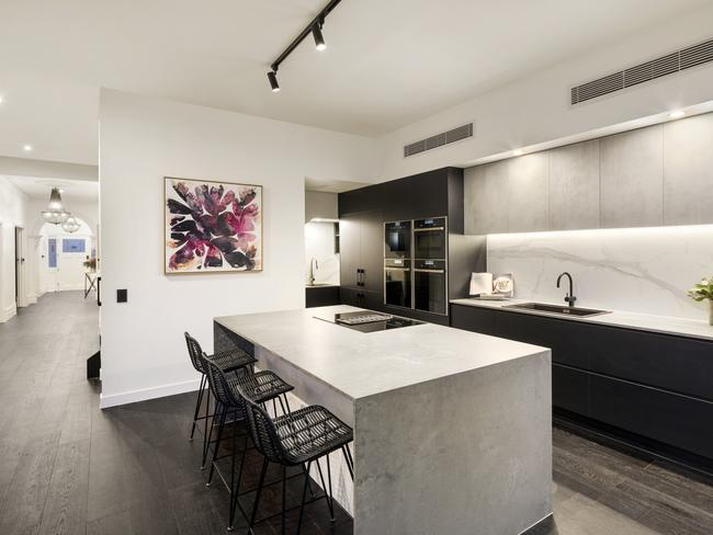 The sleek kitchen is a minimalist's dream.