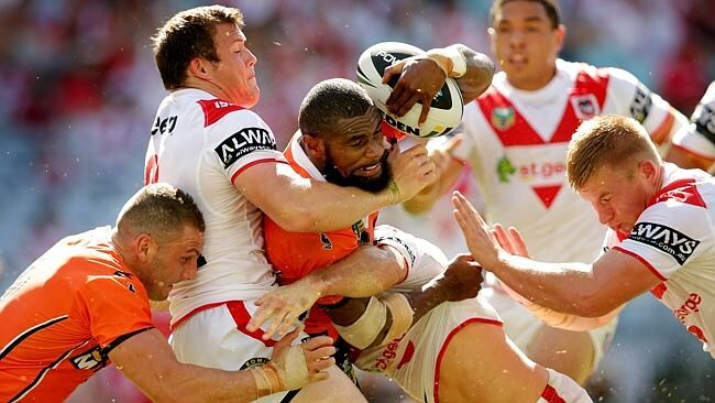 Marika Koroibete tackled by the Dragons' defence.