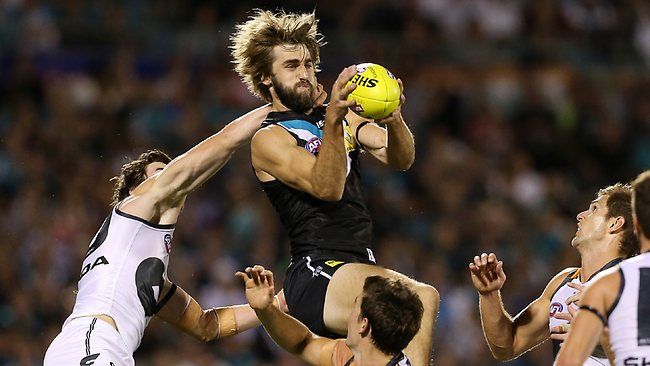 Justin Westhoff takes a strong mark. Picture: Sarah Reed