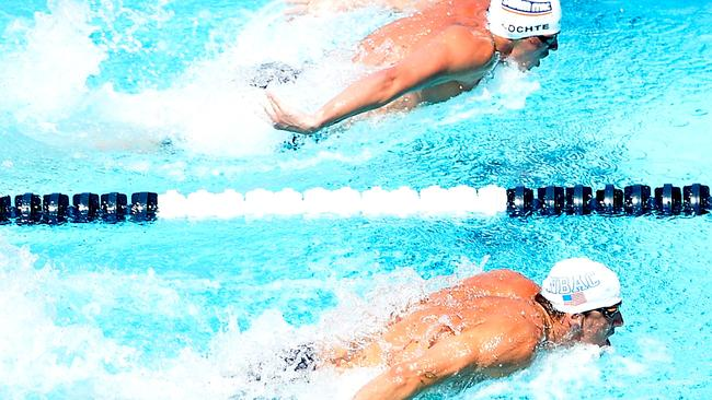 Michael Phelps leads Ryan Lochte in the 100m butterfly.
