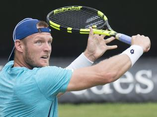 Australia's Sam Groth returns the ball to Austria's Dominic Thiem in their round of sixteen match at the ATP Mercedes Cup tennis tournament in Stuttgart, southwestern Germany, on June 9, 2016. / AFP PHOTO / THOMAS KIENZLE