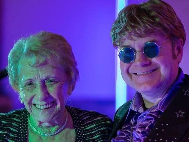 Elton John's mother Sheila Farebrother with impersonator Paul Bacon at her birthday. Picture: Supplied