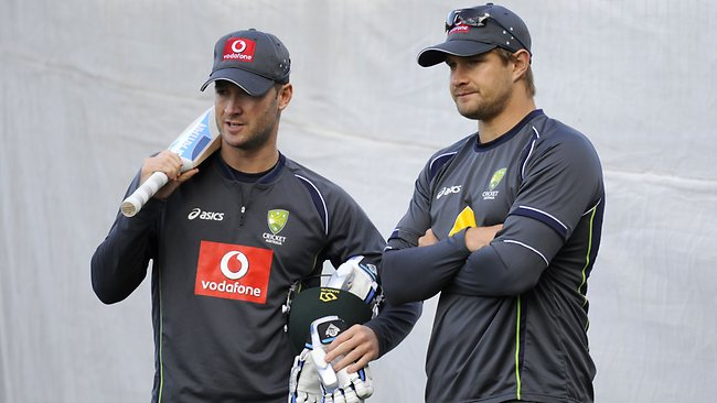 Michael Clarke and Shane Watson look on during an Australian net session.