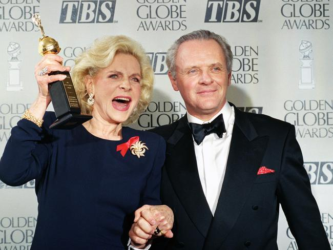 Still full of life ... Lauren Bacall holding up her Cecil B. DeMille Award for Lifetime Achievement as she holds hands with actor Sir Anthony Hopkins at the 50th annual Golden Globe Awards.