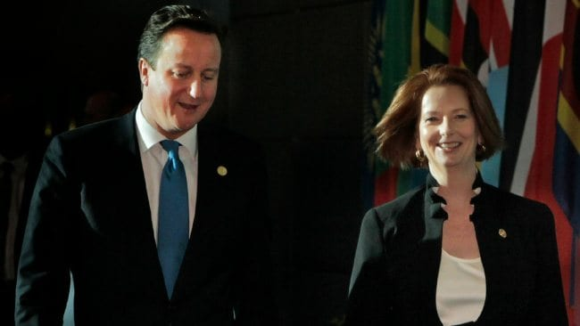 David Cameron and Julia Gillard at CHOGM in Perth last month. Was Mr Cameron taking notes on how Ms Gillard speaks? Picture: Andrew Meares