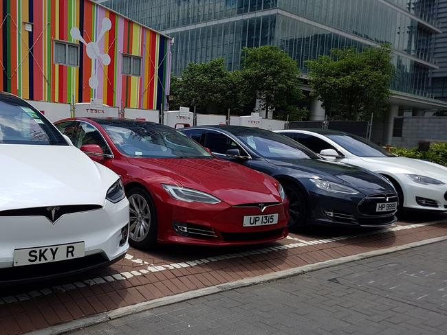 Tesla electric cars being recharged at Science Park in Hong Kong. Picture: Bobby Yip