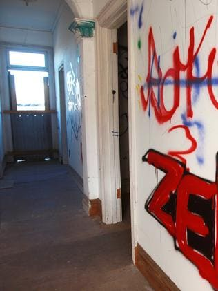 Graffiti covers the walls of the home.