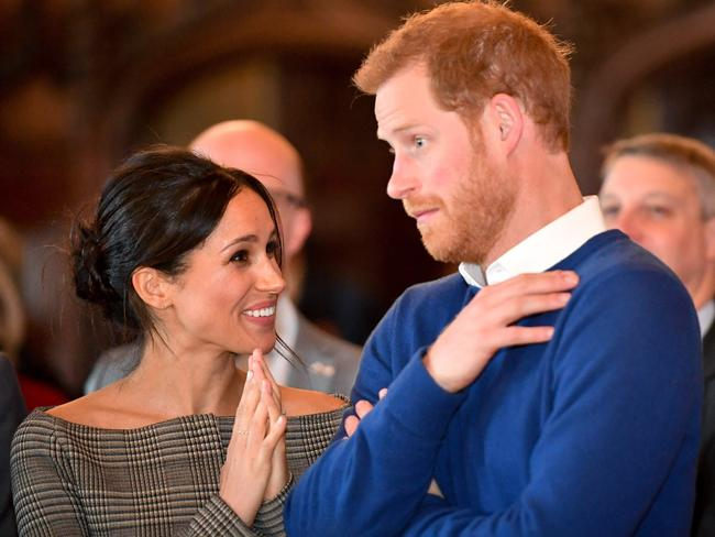 Prince Harry and Meghan Markle watch a dance performance by Jukebox Collective in the banqueting hall during a visit to Cardiff Castle. Picture: Getty
