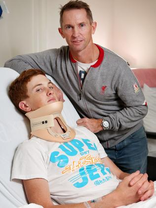 Chad Schofield, with father Glyn, in hospital with a fractured vertebrae. Picture: Mark Stewart