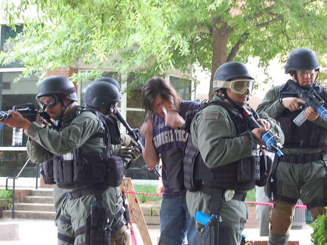 War comes home ... Georgia SWAT police engage in an exercise at a university. The need for military-style raids over relatively minor charges has been called into question by American civil liberties groups.