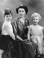 <p>Queen Elizabeth II posing for a photograph with young Prince Charles and Princess Anne. Picture: AFP</p>