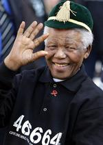 <p>Former South African President Nelson Mandela, waving ahead of the Mandela Challenge rugby union match between South Africa and the Wallabies in Johannesburg, on July 23, 2005.</p>