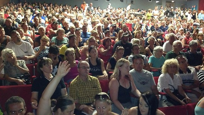 COMMUNITY: Bundaberg residents pack the Moncrieff Theatre to hear when they can go back to their flood-hit homes.