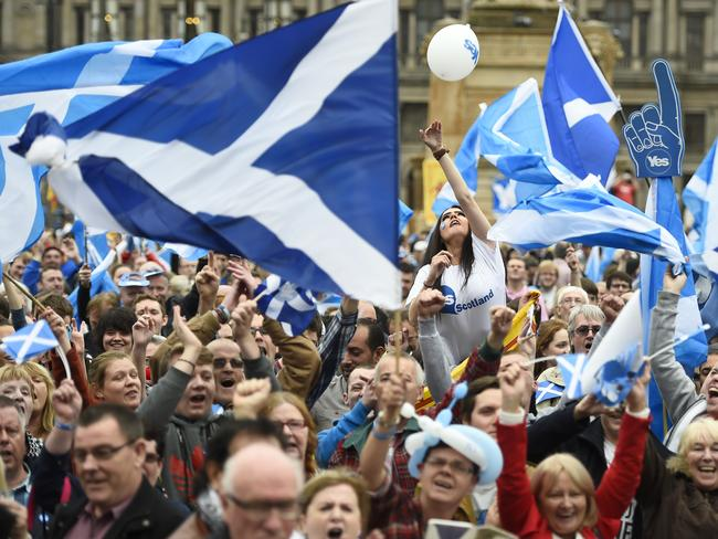 Campaigners wave Scottish Saltires at a 'Yes' campaign rally in Glasgow, Scotland. Picture: Reuters