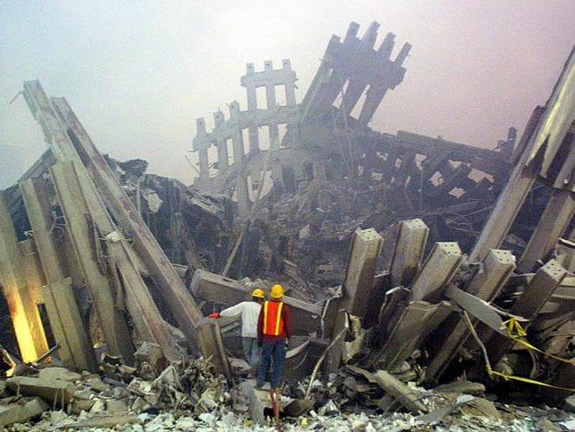 Rescue workers survey damage to the World Trade Center on September 11, 2001. Picture: AFP PHOTO/Doug Kanter