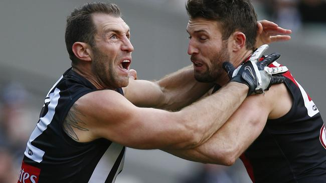 Magpie Travis Cloke locked in battle with Bomber Cale Hooker. Picture: Michael Klein