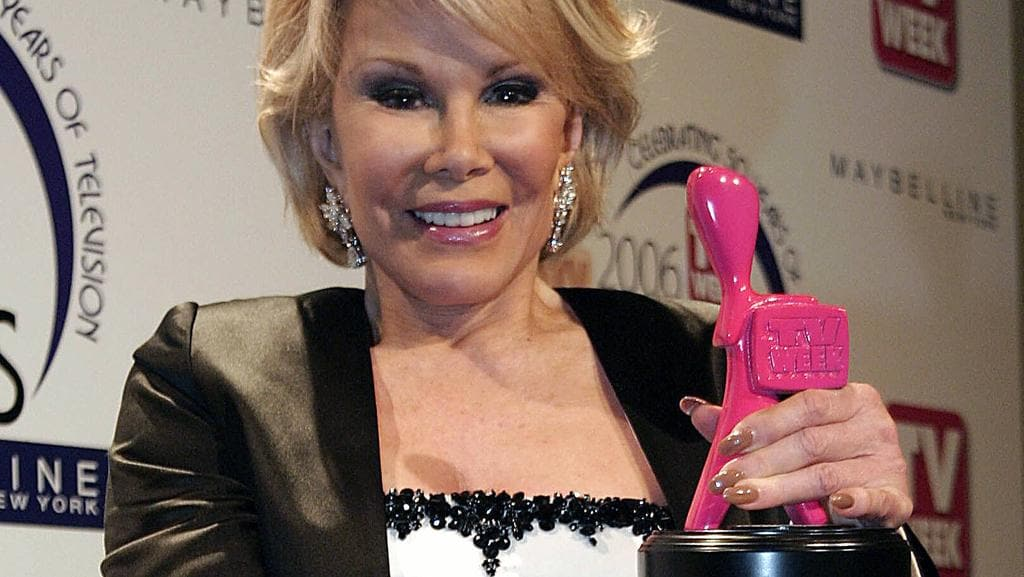 Joan Rivers with her pink Logie