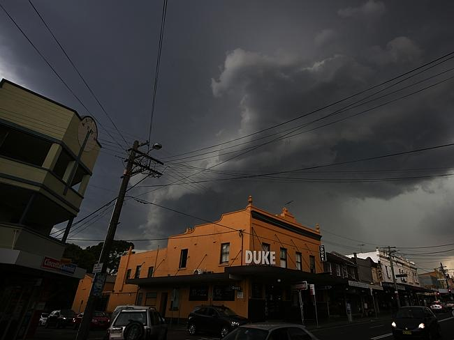 Storm clouds move in over Enmore Rd after a blisteringly hot day in Sydney. Photo: Bob Ba