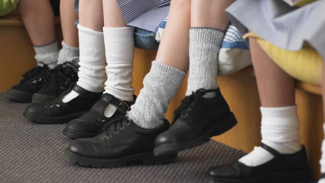 School shoes are often hot and uncomfortable, and we're asking kids to read and learn in unnatural positions like sitting behind a desk, say the researchers.